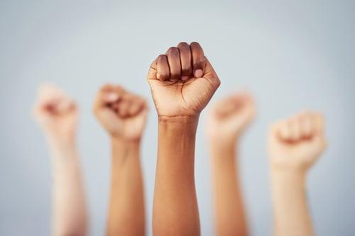 istock fists raised hands up cwli 2021